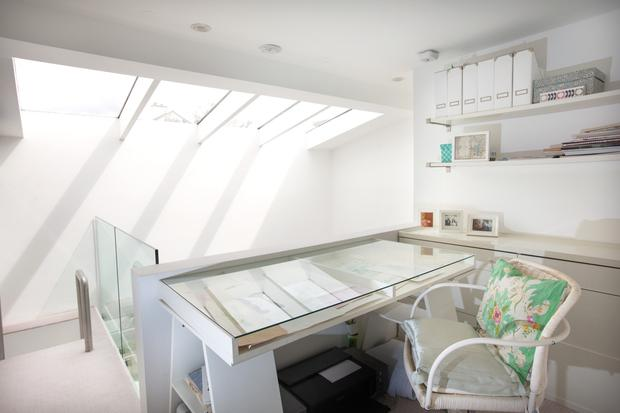 The light-filled office is on the mezzanine, along with an ensuite and a walk-in wardrobe