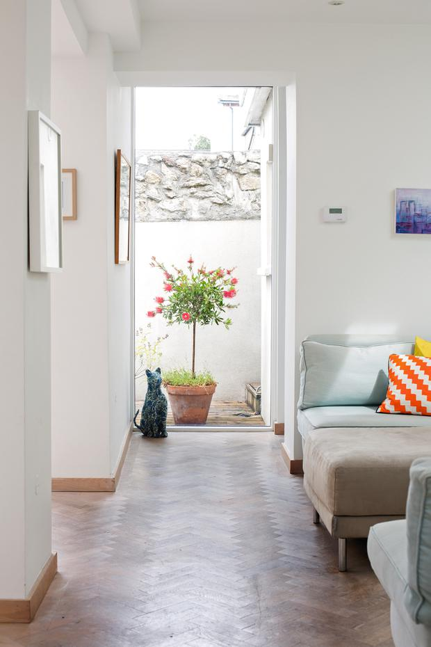 This corridor, with its panel of glass, leads to the bathroom and the utility area