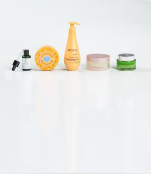 Pictured, from left, Kiehl's Nightly Refining Micro-Peel Concentrate; L'Occitane Melting Honey Exfoliating Sugars; Decleor Gradual Glow Hydrating Body Milk; Matrix Biolage Sugar Shine Polishing Hair Scrub, and Lancome Energie de Vie Sleeping Mask