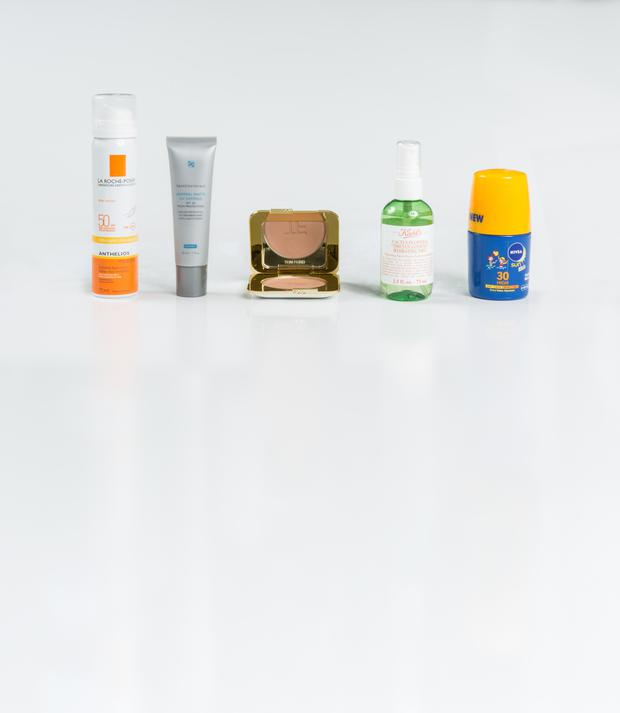 Pictured, from left, La Roche Posay Anthelios Invisible Face Mist SPF 50; Skinceuticals Mineral Matte UV Defense SPF 30; Tom Ford Bronzing Powder in Terra; Kiehl's Cactus Flower and Tibetan Gingseng Hydrating Mist; Nivea Sun Kids Caring Roll-On Email thepanel@independent.ie Photo: Kip Carroll