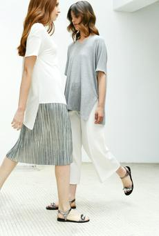 Model, far left, wears: metallic skirt, €27.99; sandals, €29.99; Model, left, wears: top, €29.99; sandals, €29.99, all Parfois. All other items, stylist's own