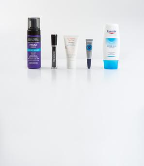 Pictured, from left, John Frieda Frizz Ease Air Dry Waves Styling Foam; M2 Beaute Eyelash Activating Serum; Avene Tolerance Extreme Mask; L'Occitane Nail and Cuticle Nourishing Oil; Eucerin After Sun Lotion. Photo: Kip Carroll