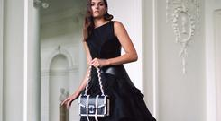 Evening dress, €3,370, Toni Maticevski; sandals, €1,030, Alaia; leather corset belt, €1,400, Loewe; bag, €1,990, Proenza Schouler