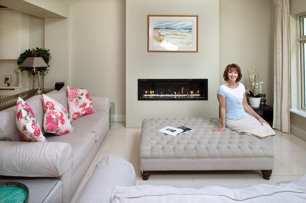 Careena in the living area of her extension. An old school friend, Glenna Lynch, of The Sofa Room, Leeson St, D2, helped with the colour schemes. Instant heat is provided with the elegant gas fire