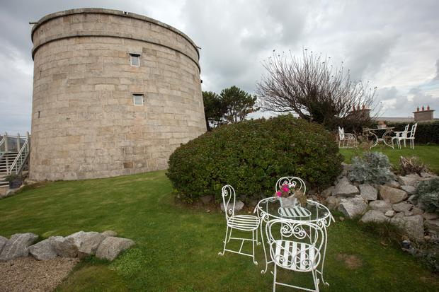 Bartra Tower is one of 28 Martello Towers built on the Irish coast in the early 1800s. The ashlar-cut stone on the exterior makes it particularly elegant