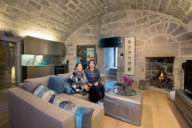 Simone Stephenson with her mother, Helen. This space used to be the very basic quarters of the soldiers who once occupied the tower, but an oak floor, lots of luxurious furnishings, and interesting paintings have transformed it into a stylish, yet cosy, living space