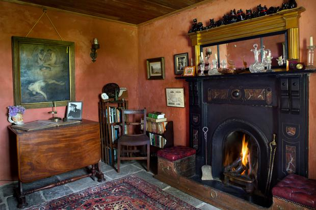 The rooms in the house, like this parlour, are small, and Alice enlivened them with interesting period wall colours. The Sunderland table was bought in Bantry, while she found the painting of Lucifer on the streets of New York. Alice collects black cats for luck. She also has a live cat called Madge. 'Madge is a pisser, but I love her,' Alice notes