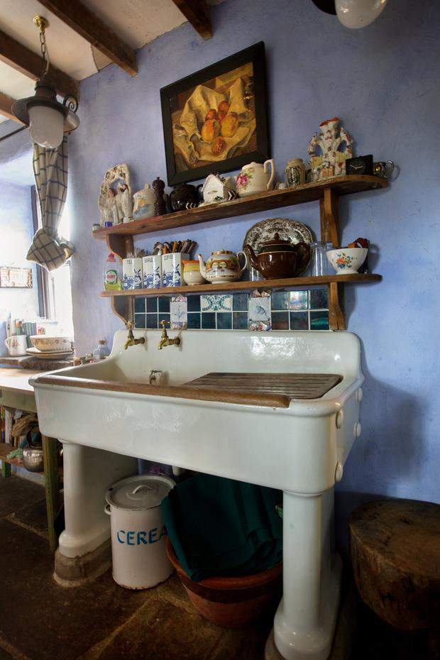 A detail of Alice's kitchen, featuring a gorgeous old sink