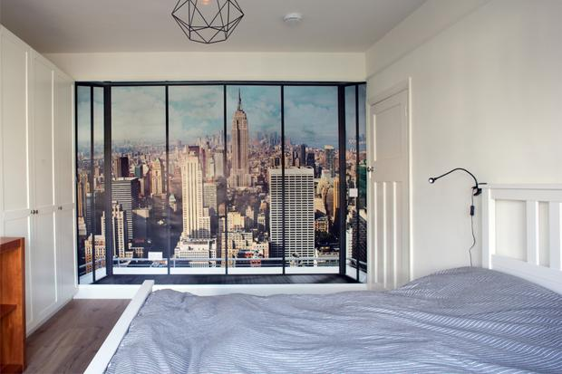 Will opted for a feature wall in his bedroom, where a scene depicts the New York skyline