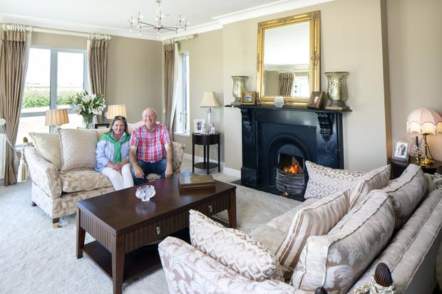 Marita and Peter in the drawing room. A cream hand-made shagpile carpet was on Marita's wish list, and of course she got it. The mantelpiece is from the old farmhouse originally on their land
