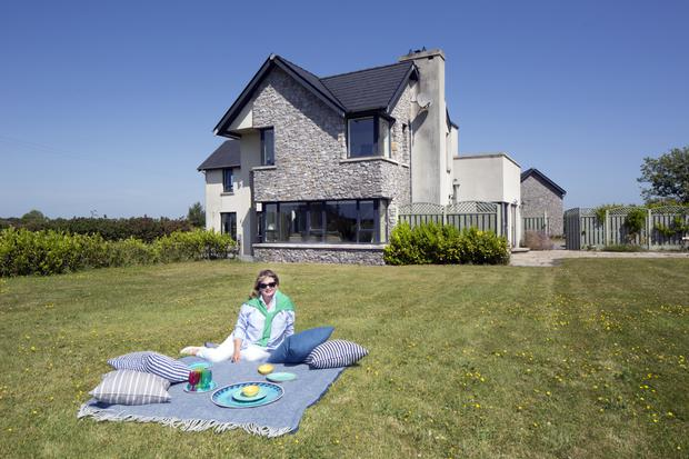 Marita Varley in front of the stunning house designed by her husband Peter Collier, an architect and farmer. Together they run the award-winning Drummond House garlic and asparagus farm. The house is designed around the position of the sun throughout the day