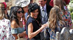 Britain's Meghan, Duchess of Sussex, arrives at the wedding of Charlie Van Straubenzee and Daisy Jenks at the Church of St. Mary the Virgin, Frensham, in Surrey, Britain, August 4, 2018. REUTERS/Peter Nicholls