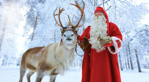 Santy with Rudolph. The magic only works when you believe