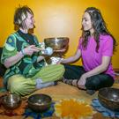 Good vibrations: Katie Byrne tries out the Sound Bath at The Sanctuary with tutor Simone Meschnig. Photo: Kyran O'Brien