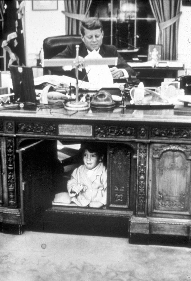 John Kennedy Jr playing in the Oval Office at the White House, 1963