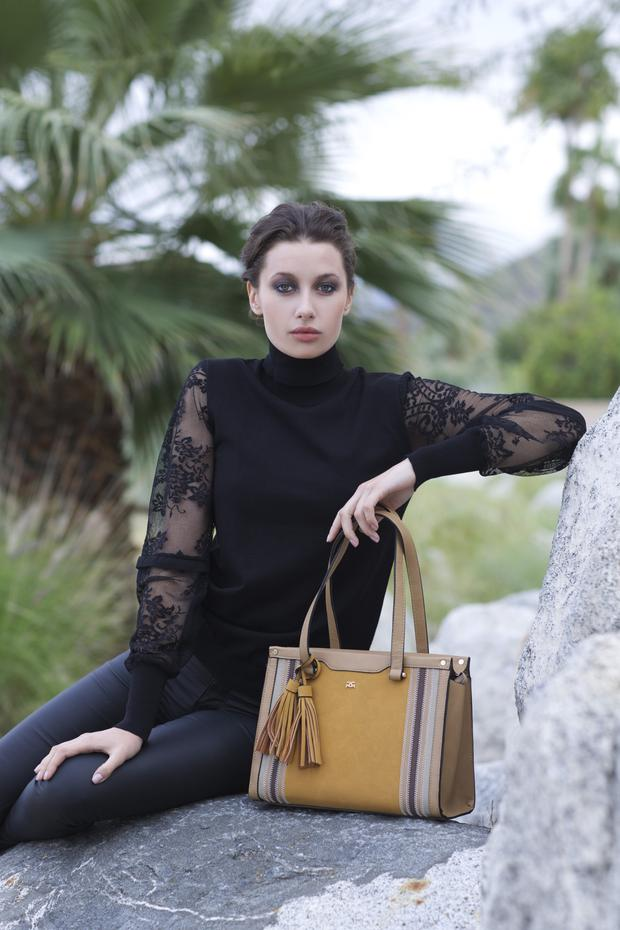 Jumper, €52; leather-look jeans, €74.95, both Rant & Rave. Bag, €42, Gionni