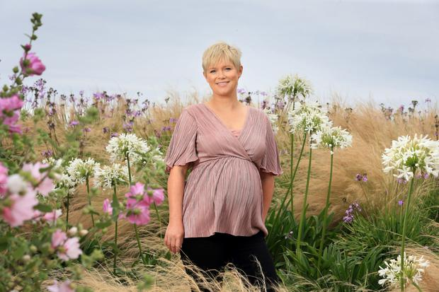 Cecelia Ahern among the blooms at Portmarnock Links Hotel, Dublin. Her new book 'Postscript' is released this Thursday. Photo: Frank McGrath