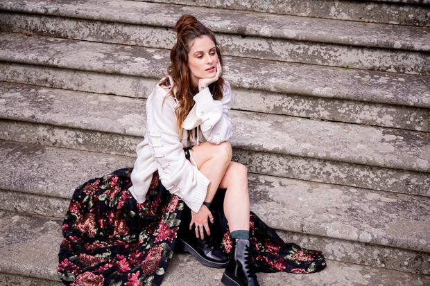 Gown, €695, Synan O Mahony, The Design Centre, designcentredublin.com; jumper, €450, McQ; boots, €325, Claudie Pierlot, both Brown Thomas; socks, €12.50, Tights Dept., tightsdepartment.ie. Photo: Taine King