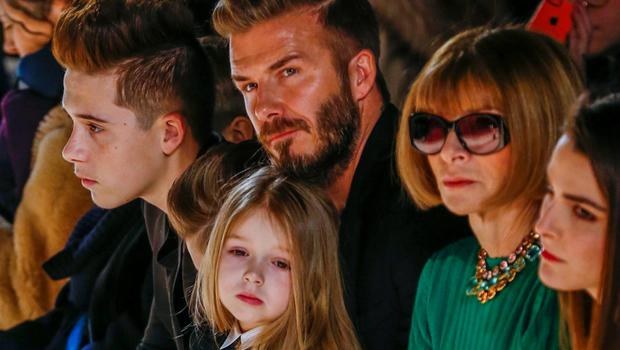 BECKS: David Beckham and his children, and American Vogue editor Anna Wintour watch the show