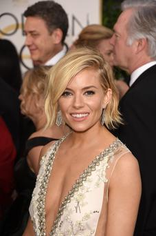 Actress Sienna Miller's dewy look at the golden globes