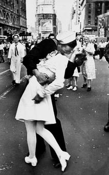 JUBILANT: A sailor and a 'nurse' kiss in Times Square as New York City celebrates the end of WW2. Photo: Getty
