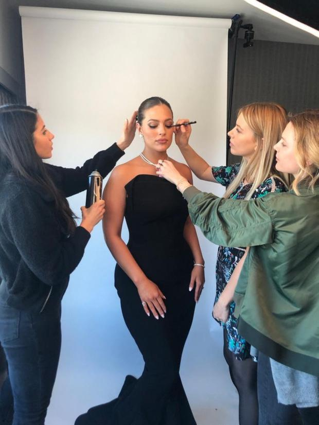 Behind the scenes: Kate (second from right) working with model Ashley Graham