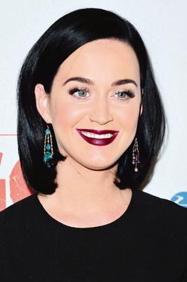 Statement lips: Katy Perry models a bold purple lip colour.