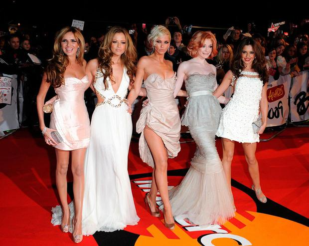 Sarah Harding (centre) with her bandmates from Girls Aloud. Photo: Ian West/PA