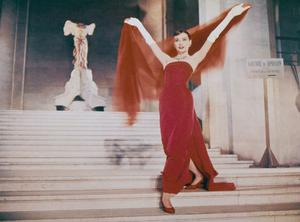 Hepburn descends the Daru Staircase at the Louvre in Paris, in a scene from the film 'Funny Face', 1957