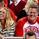 Tennis player Caroline Wozniacki and J.J. Watt of the Houston Texans look on from the crowd in the first half of the game between the Duke Blue Devils and the Wisconsin Badgers during the NCAA Men's Final Four National Championship at Lucas Oil Stadium on April 6, 2015 in Indianapolis, Indiana. (Photo by Streeter Lecka/Getty Images)