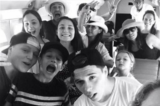 The photo shows clockwise: David Beckham (40), Gordon Ramsay (49), Victoria Bekcham (41), Gordon's wife Tana (41), the Beckham's youngest child Harper (4), Brooklyn (16), Gordon's daughter Matilda who appears to be taking the snap (13), Cruz (10), the Beckham's middle son Romeo (13), Jack Ramsay (16), the Ramsay's oldest daughter Meghan (18) and Holly Ramsay (16). Instagram