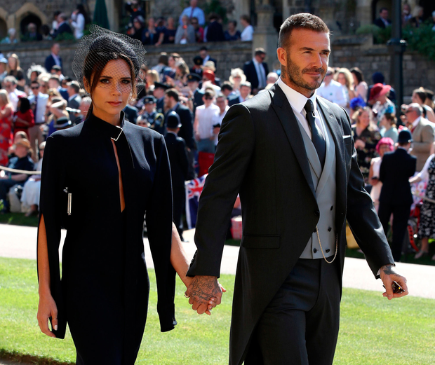 Attend it like Beckham: Critics said Victoria and David Beckham looked unhappy at the royal wedding. Photo: Getty Images