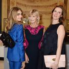 'If I put my name to something, I want to know I've at least had my full stamp on it' - Delevingne with her mother, Pandora, and sister, Chloe, at the launch of her handbag collection in London in February. Photo: Getty.
