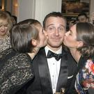 Kirsty Blake Knox and Laura Butler kiss Michael Fassbender at the IFTAs.