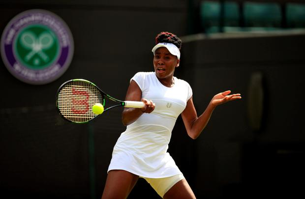 Power: US player Venus Williams in action on the court yesterday