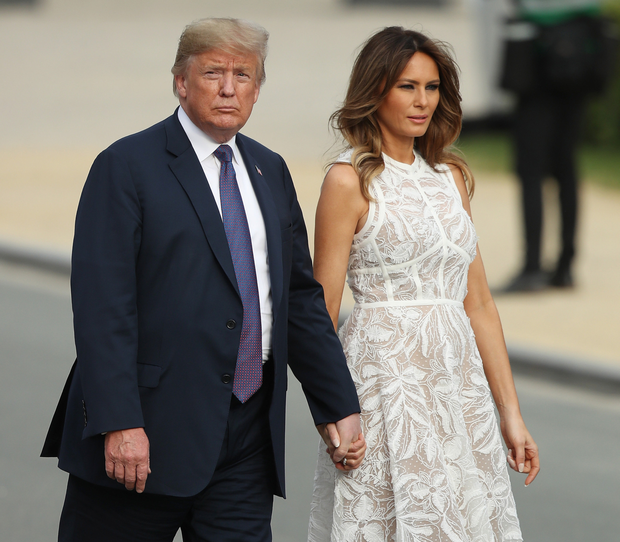 The First Lady wears an almost 'naked' dress while accompanying her husband to the Nato summit. Photo: Getty Images