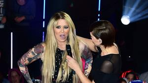 Jenna Jameson, with the show's host Emma Willis, leaves the Big Brother house at Elstree Studios, Borehamwood, during a fake eviction