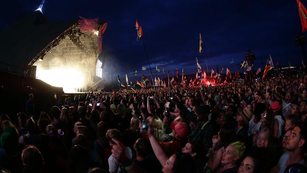 The crowd watch Kanye West performing on The Pyramid Stage at Glastonbury