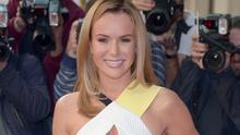 Amanda Holden as Britain's Got Talent supremo Simon Cowell has revealed how he conned his co-star into thinking she was being dumped from the show