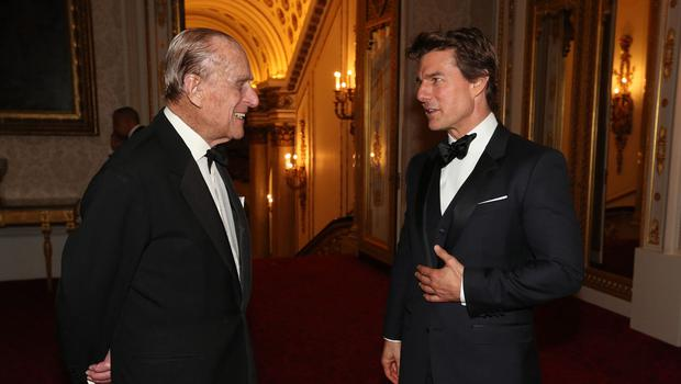 The Duke of Edinburgh meets Tom Cruise during a dinner at Buckingham Palace to mark the 75th anniversary of the Outward Bound Trust.