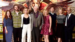Jennifer Lawrence with Donald Sutherland and the cast of The Hunger Games: Mockingjay, Part 1