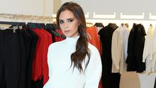 Victoria Beckham answered questions as she walked around her store in London's Mayfair