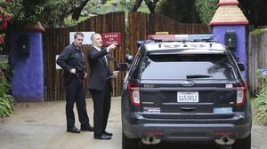 Los Angeles police officers and private security outside the homes of Debbie Reynolds and her daughter Carrie Fisher in Los Angeles (AP/Reed Saxon)