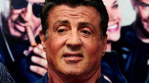 """Sylvester Stallone posed for a picture with three tourists who had run up the """"Rocky steps"""""""