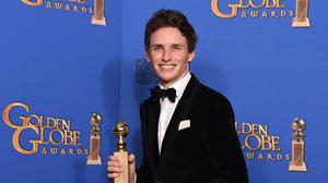 Eddie Redmayne shows his joy at scooping the award for best actor in a motion picture - drama for The Theory Of Everything (AP)