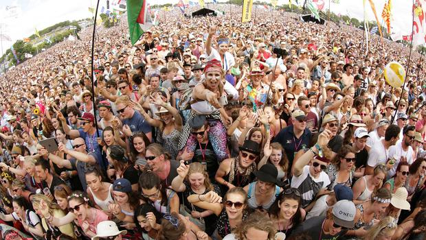 The crowd watch George Ezra performing on The Pyramid Stage at the Glastonbury Festival