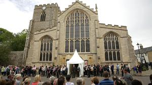 Members of the public gather outside St Mary's Church in Bury St Edmunds for the wedding of ex-Corrie actress Michelle Keegan to The Only Way Is Essex star Mark Wright