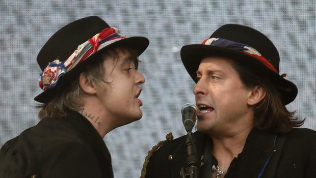 Pete Doherty, left and Carl Barat of The Libertines perform on the Pyramid stage during (AP)