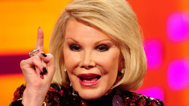 Joan Rivers remains in hospital after going into cardiac arrest at a doctor's office