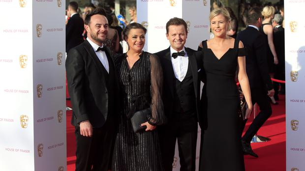 Anthony McPartlin and Declan Donnelly aka Ant and Dec with wives Lisa Armstrong and Ali Astall attending the Bafta TV Awards